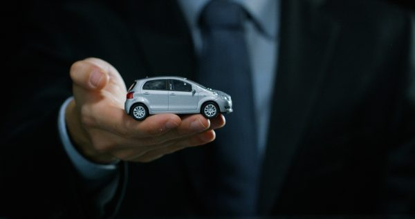 hand holding car